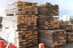stacks of Rustic Wood Hub's reclaimed corral board